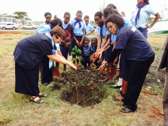 Shariffa and the girls planting a tree after their inaugraition into the Kenya Girl Guides Association