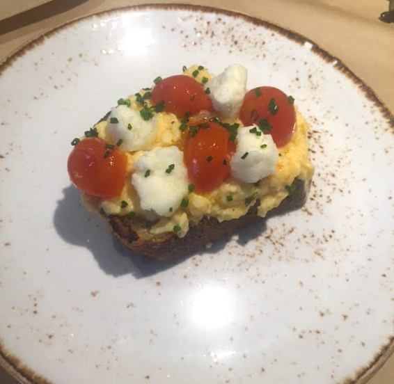 Greek scrambled eggs on grilled sourdough bead with wilted cherry tomatoes & barrel matured feta.