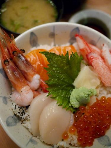 chirashi sushi, with scallops, amaebi shrimps, salmon, and ikura