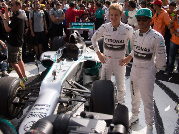 Nico Rosberg and Lewis Hamilton, after demo run with F1 race car