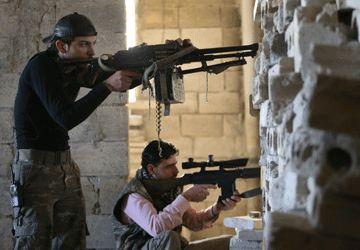 Des tireurs appartenant à l'un des groupes d'opposition au régime Assad. (Photo: AP)