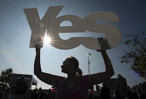 A 'Yes' supporter is pictured in Edinburgh …