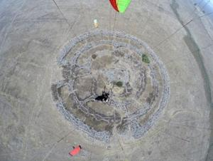 A general aerial view shows a prehistoric stone monument, …