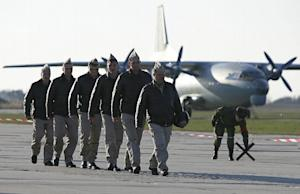 Russian air force pilots walk on the tarmac upon their…