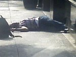 The body of a man lies on the sidewalk near the Empire State Building following a shooting in New York