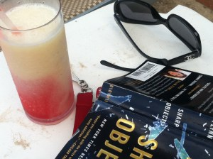 There's nothing that a stiff cocktail and a good book in the sun can't cure....