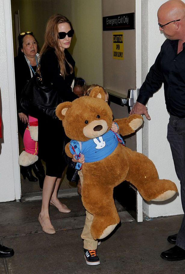 Angelina Jolie arrived back in Los Angeles with giant teddy bears