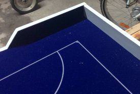 I fixed some self-adhesive velours film on both goal side barriers. Your players will be thankful for this protection!