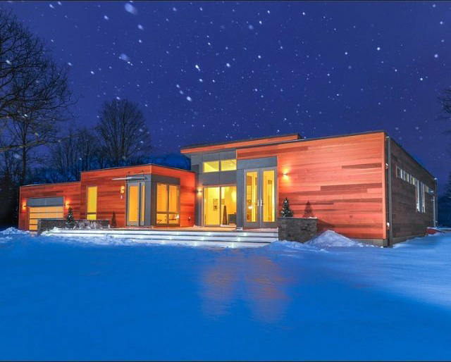 Custom modern house during a snow storm. Copake, NY.
