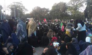 Sit in outside governor House