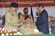 COAS pinned the badges of rank on the shoulders of Lieutenant Gen Zamir Ul Hassan Shah