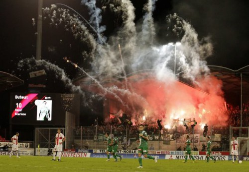 FC St-Gallen's supporters celebrates a goal during their Swiss Super League soccer match against FC Sion in Sion September 1, 2012. REUTERS/Denis Balibouse (SWITZERLAND - Tags: SPORT SOCCER)