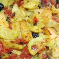 Baccalà al forno patate, olive nere, pomodorini