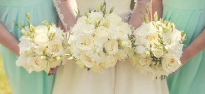 Bride with bridesmaids holding wedding bouquets