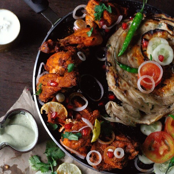 A favorite restaurant dish that you can now make anytime you like, at home in just 40 mins. Succulent, juicy with spicy complex flavors, it gets a liberal squeeze of fresh lemon juice to turn it into an irresistible spicy and sour dish. These tandoori chicken made with a chef's spice rub are just the perfect way to end your weekend, or just about any day of the week.