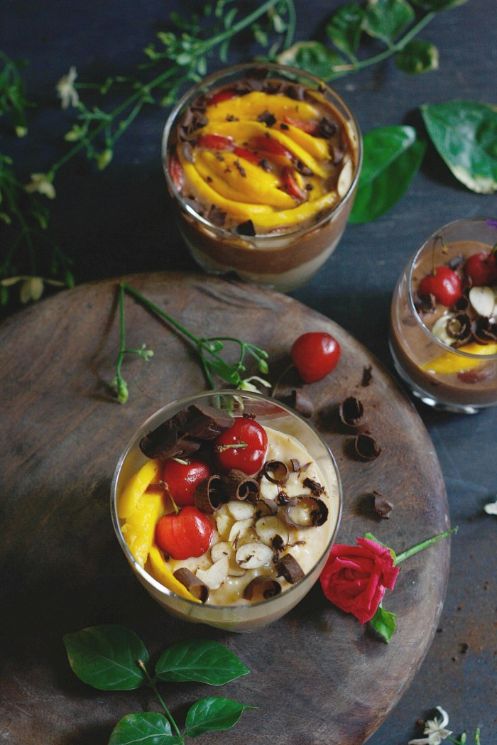Chocolate and caramel rice pudding is a super indulgent dessert where good old kheer gets a modern avatar with this simple elegant layered glass of chocolate and caramel rice pudding, topped with fresh mango, cherries and toasted almond flakes.