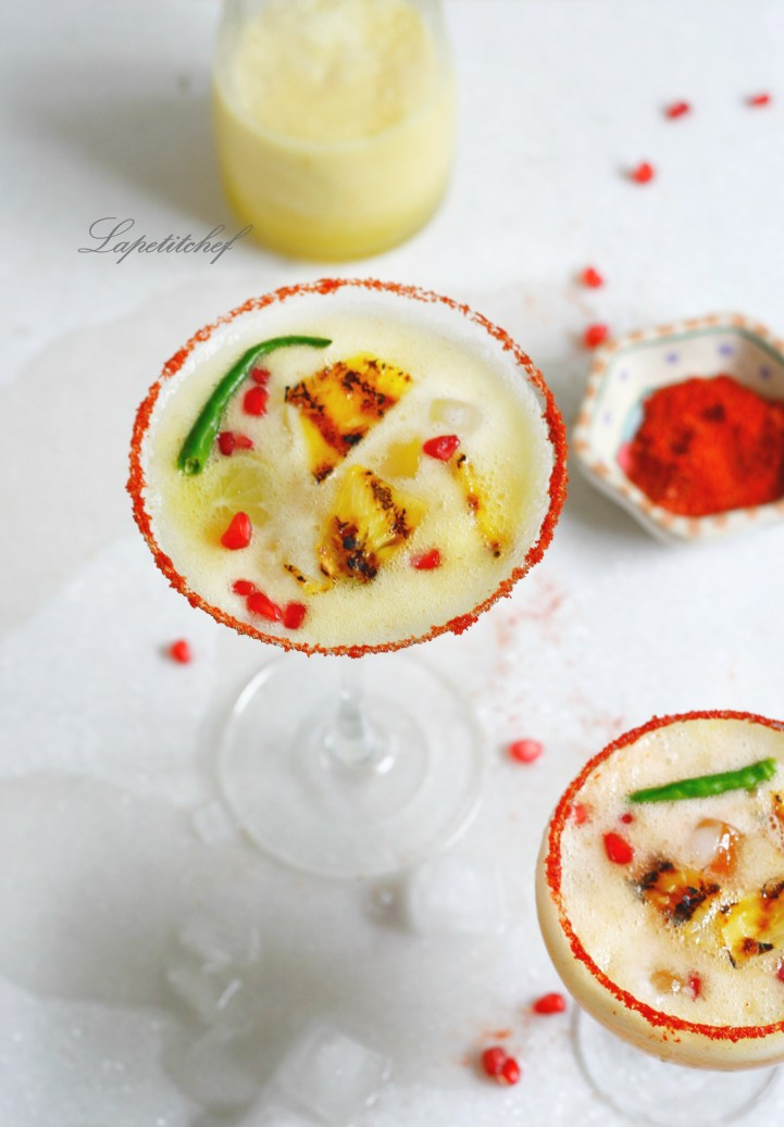 A delicious sweet and sour jalapeno infused tequila drink made even more refreshing by grilling pineapples and the addition of grenadine. Served with a chili + salt rim, these cocktails are the best drink ever!