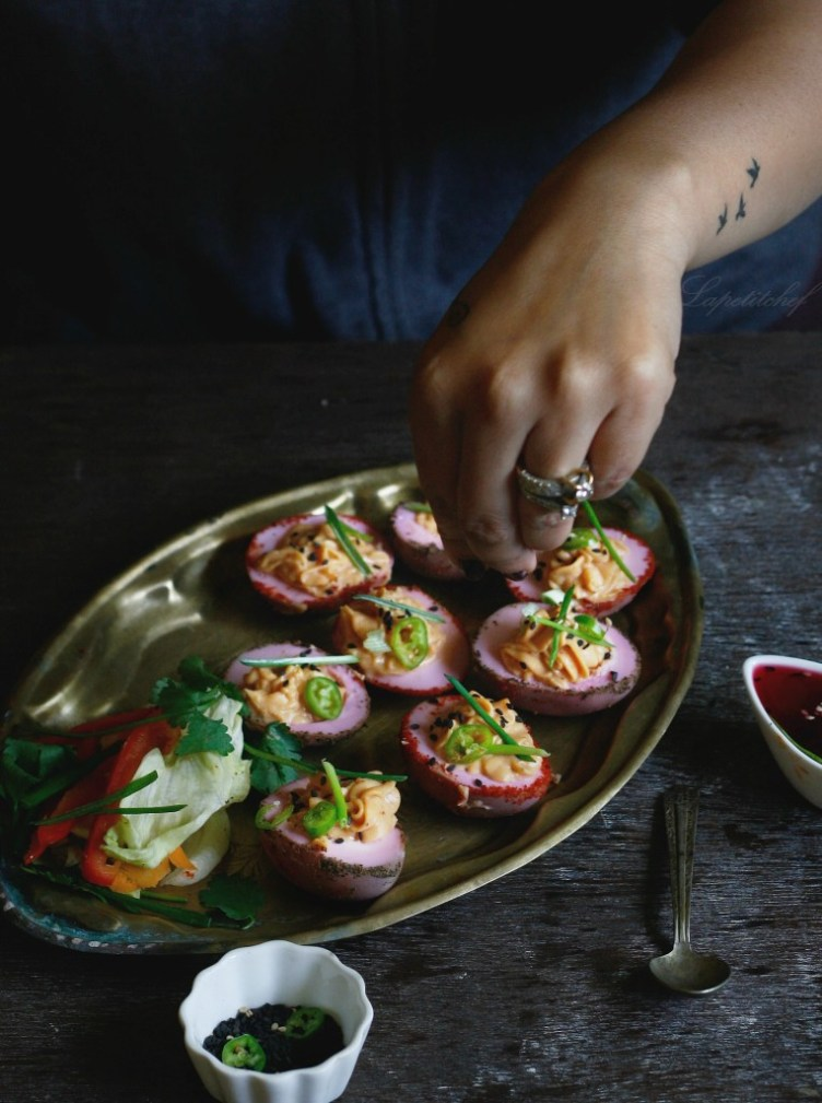 Sriracha beet pickled deviled eggs with sesame