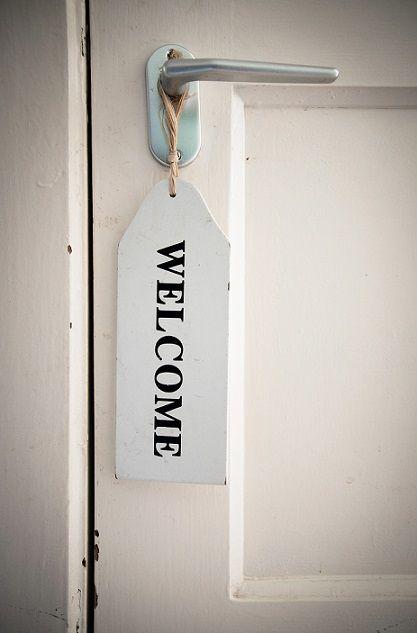 stockvault-welcome-sign-on-door131469