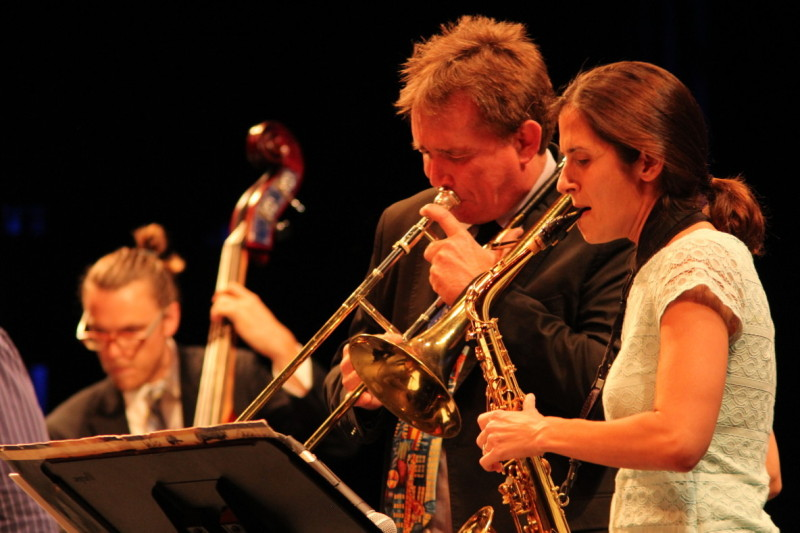 Joey Sellers (center) played the trombone alongside Ariel Alexander (alto saxophone) play on stage in the McKinney Theatre. (Photograph/Niko LaBarbera)