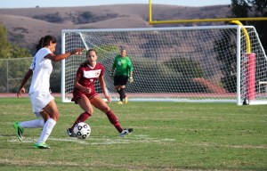 No.5 Cassidy Celani, defense, freshman, guides the ball away from her team's goal. (Photographer/Anibal Santos)