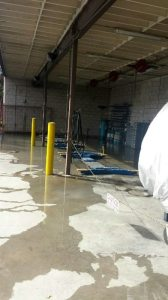 Water from the leak originated from under the auto lifts in the outside Auto Lab. (Photo Credit: Auto Tech Students)