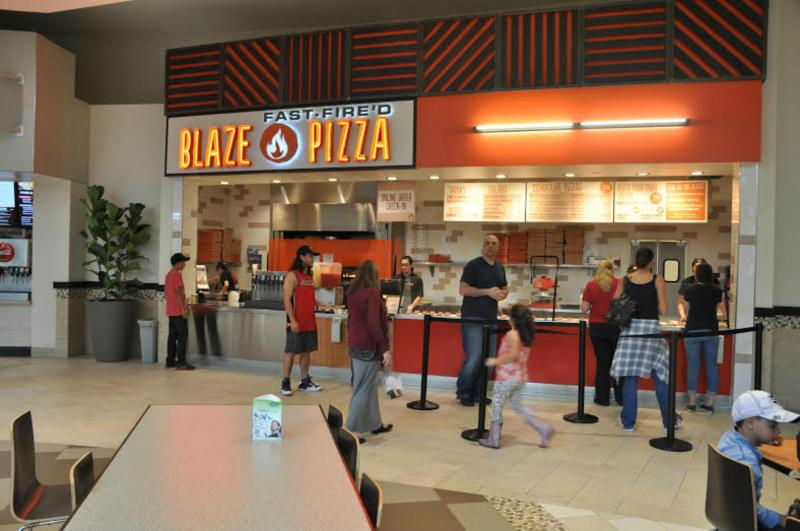Hungry pizza lovers stand in line thinking of what they will create this time. (Photo by Makaila Ho)