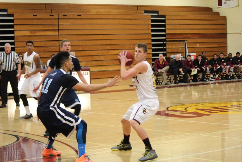 Saddleback College's Dusty Baker looks to pass the ball to one of his teammates against Irvine Valley College. (Photograph courtesy of Saddleback Sports Information)