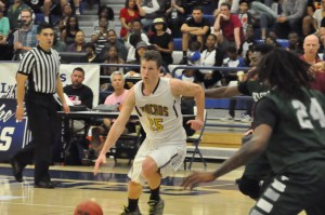 Sophomore Dusty Baker drives past a East Los Angeles defender. Baker was named tournament MVP. (Photo courtesy of Jason Boggs/CCCAA Sports)