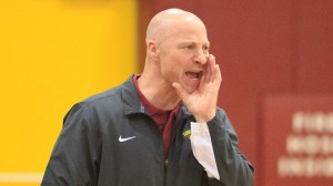 Saddleback head basketball coach Andy Ground (bald, middle) has grown hair after winning his third state championship. (Saddleback Sports Information)