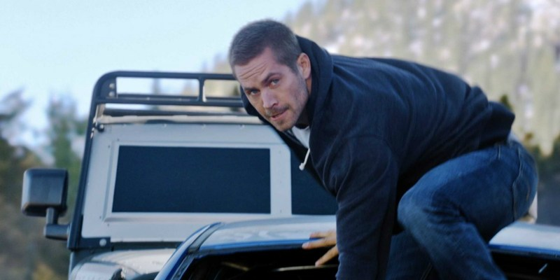 Brian O'Conner (Paul Walker) prepares to make a a giant leap off his car. (Photo/Business Week)