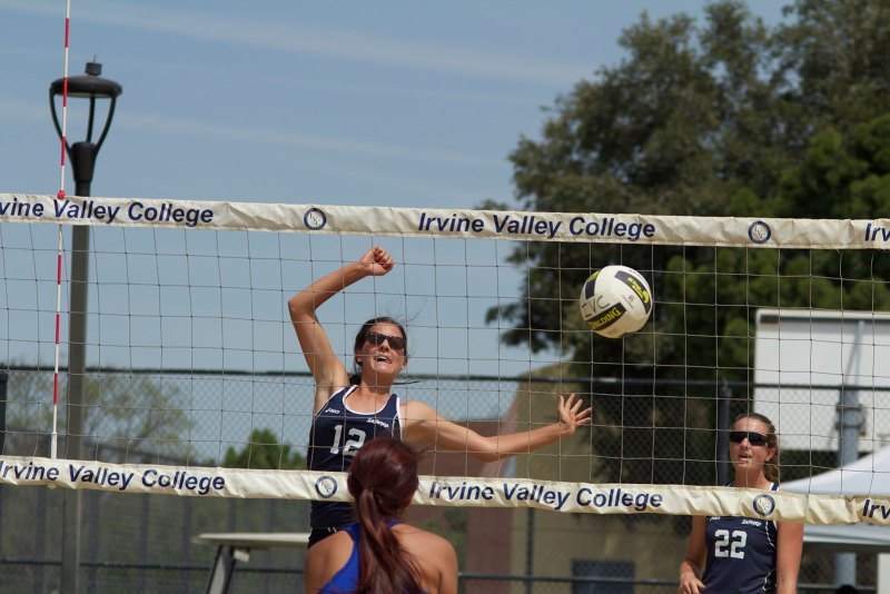 Kobi Pekich (#12) jumps to attempt to spike the ball past a defender. The Lasers defeated both Rio Hondo College and Santa Ana College, 5-0 Friday and started their conference season, 1-0. (Niko LaBarbera | Lariat)