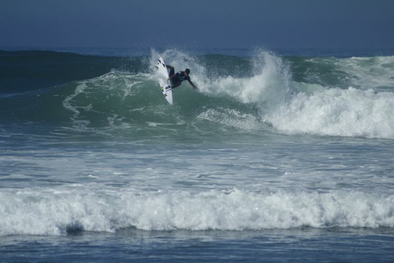 Felipe Toledo performing an air reverse at Lowers during the 2014  Hurley Trestles Pro. (Photo by Niko LaBarbera)