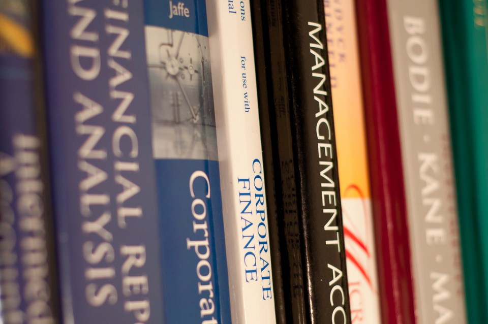 Many student-athletes are required to have several books to succeed academically. (John Liu/ Creative Commons)