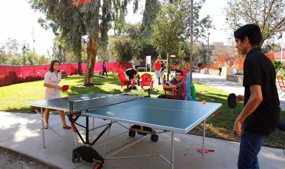 Students enjoying a game of ping pong in the Saddleback quad between classes.