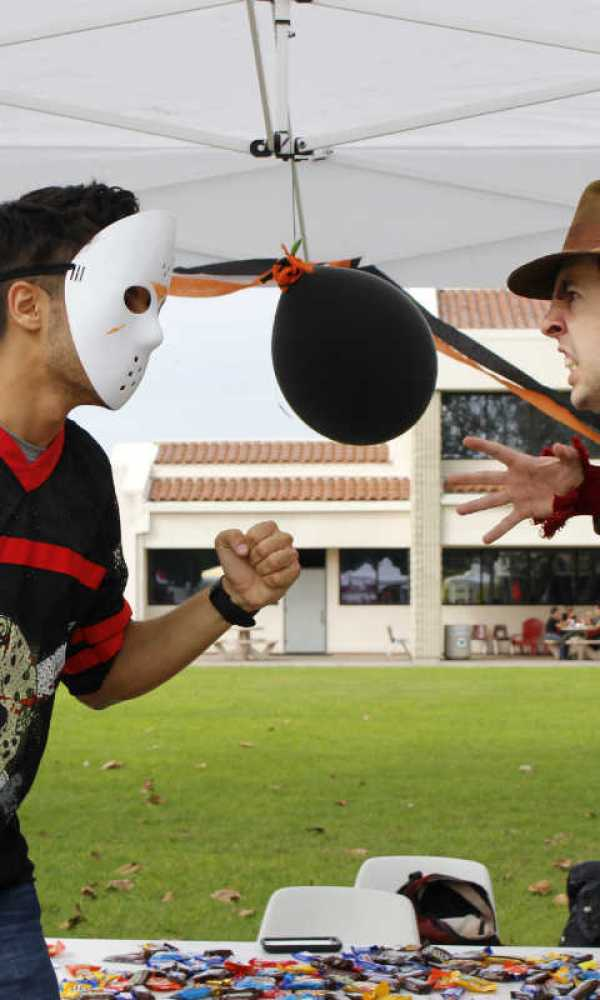 Jason Voorhees and Freddy Krueger go head to head on the stage of the Halloween contest. (Angel Grady/Lariat)