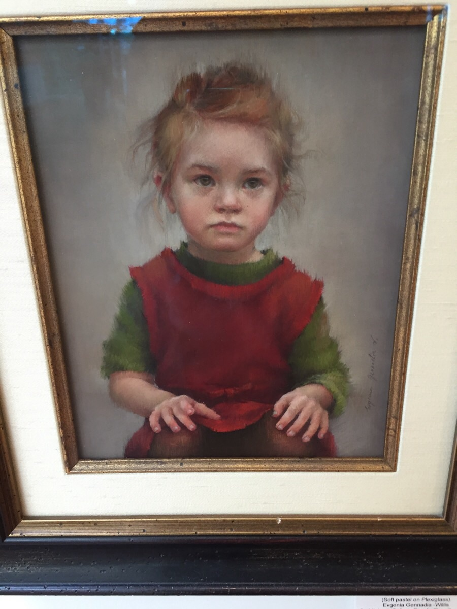 "Evgenia Gennadia-Willis' soft pastel portrait on plexiglass entitled ""Anna"" is on display on the third floor of the Saddleback College library. (Josh Zent/Lariat)"