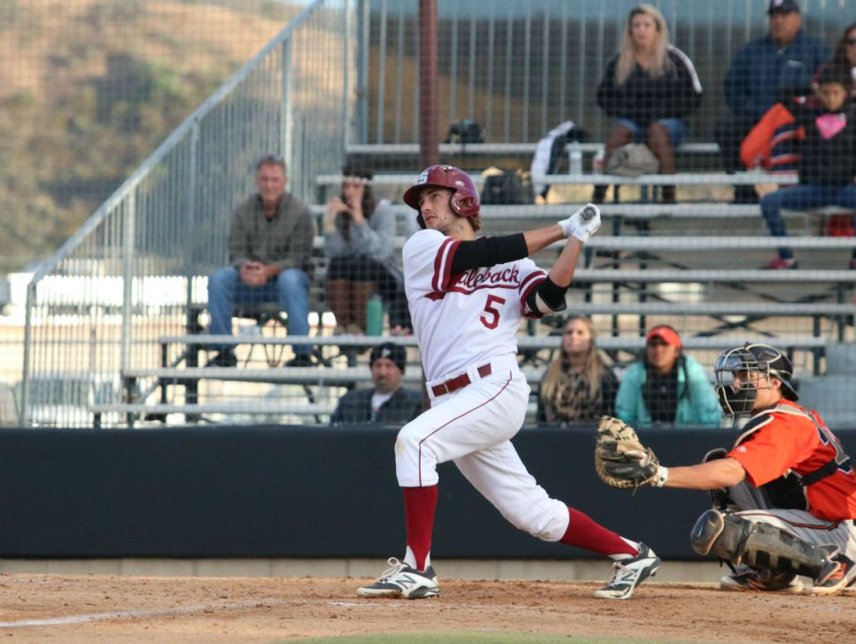 Gauchos outfielder Andrew Wilson watches his hit go into the outfield. Saddleback won the first game Saturday, but were crushed in the second, ending their season. (Nick Nenad/Lariat)