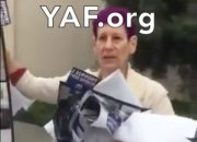 Professor Lovett recorded by group of students from young Americans for freedom removing 9/11 posters