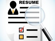 Resume and magnifying glass human resource recruitment