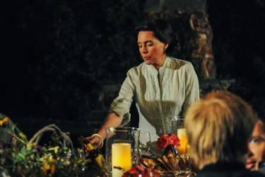 Housekeeper Maria Castillo (Julie Carmen) arranges the dinner table in LAST WEEKEND.