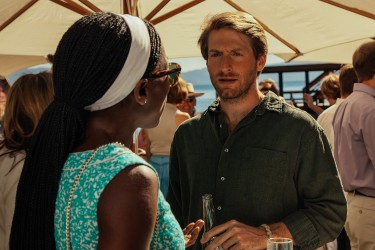Nora Finley-Perkins (Rutina Wesley) and Sean Oakes (Fran Kranz) at the benefit in LAST WEEKEND.