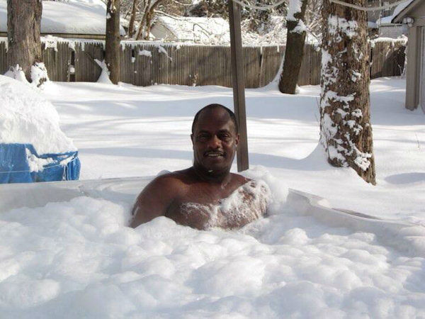 Man Celebrates Winter Storm in Hot Tub