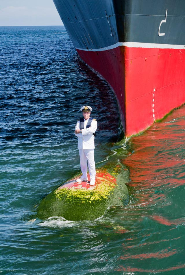 Captain Standing on Bulbous Bow of Queen Mary 2
