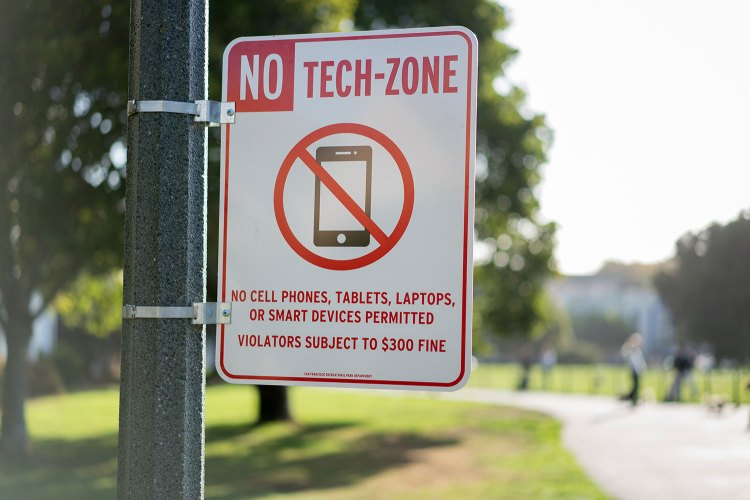 no tech-zone sign on pole