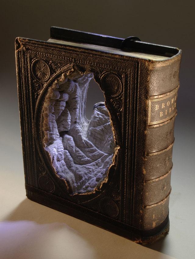 Carved book landscape sculptures by Guy Laramee