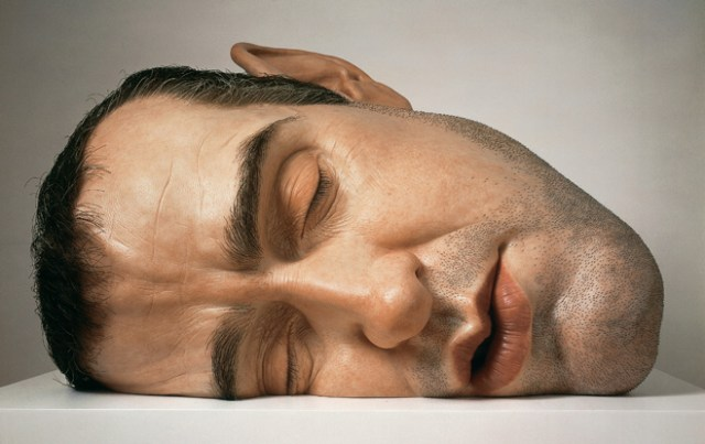 Realistic human figure sculptures by Ron Mueck