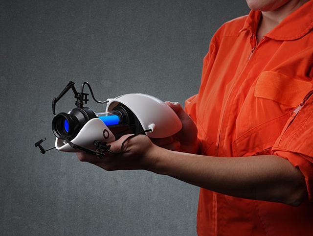 Portal 2 Miniature Replica Portal Gun at ThinkGeek