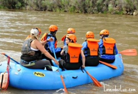 family goes river rafting