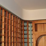 Wine room, racking installed, detail before accent light and trim install.
